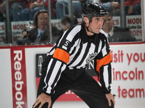 Struck By Puck, NHL Ref Helped Off Ice At Pepsi Center